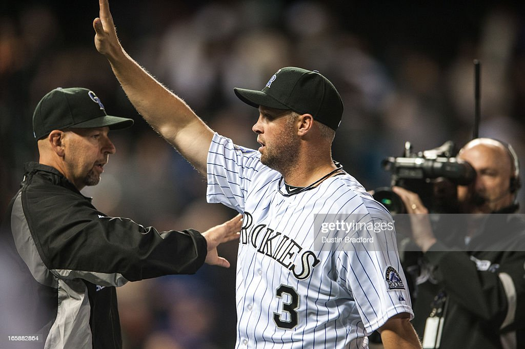 Michael Cuddyer #3 of the Colorado Rockies gives a high five to Walt Weiss #22 as he is announced as the player of the game after a game against the San Diego Padres at Coors Field on April 6, 2013 in Denver, Colorado. The Rockies Beat the Padres 6-3.