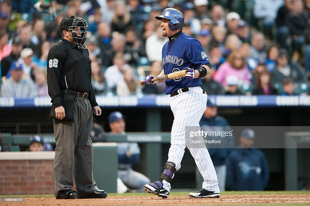 Michael Cuddyer #3 of the Colorado Rockies has a word for umpire Clint Fagan #82 at Coors Field on May 4, 2013 in Denver, Colorado. The Rockies led the Rays 1-0 after one inning.