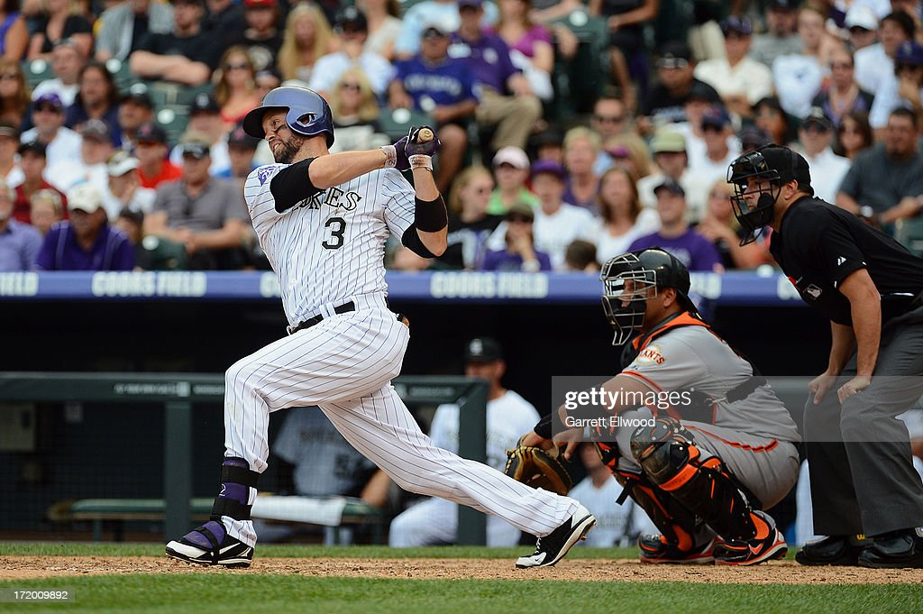 <a gi-track='captionPersonalityLinkClicked' href=/galleries/search?phrase=Michael+Cuddyer&family=editorial&specificpeople=208127 ng-click='$event.stopPropagation()'>Michael Cuddyer</a> #3 of the Colorado Rockies hits a single in the eighth inning against the San Francisco Giants to extend his hitting streak to 27 games at Coors Field on June 30, 2013 in Denver, Colorado.