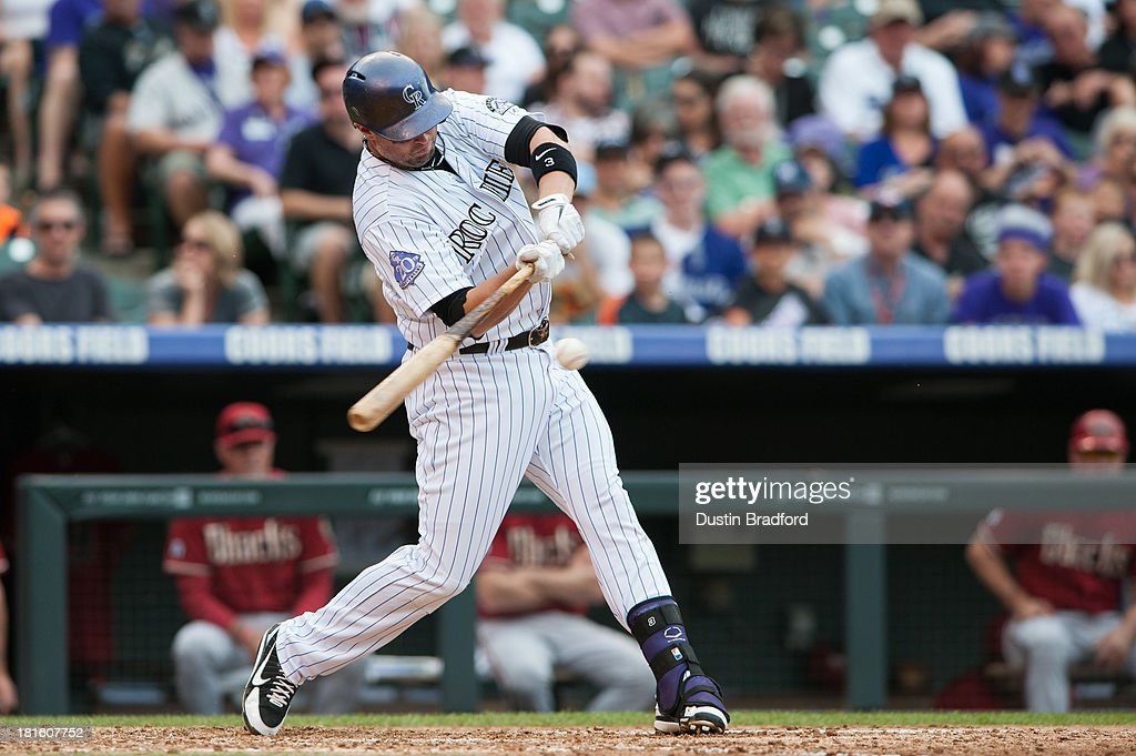 <a gi-track='captionPersonalityLinkClicked' href=/galleries/search?phrase=Michael+Cuddyer&family=editorial&specificpeople=208127 ng-click='$event.stopPropagation()'>Michael Cuddyer</a> #3 of the Colorado Rockies hits a third inning single against the Arizona Diamondbacks at Coors Field on September 22, 2013 in Denver, Colorado.