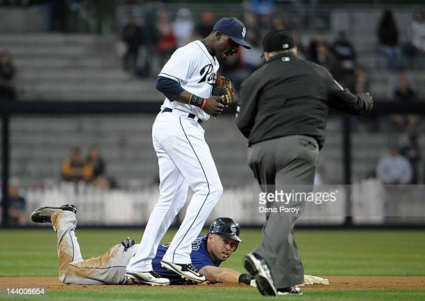 Michael Cuddyer of the Colorado Rockies is called out by umpire Chad Fairchild after being tagged by Orlando Hudson of the San Diego Padres while...
