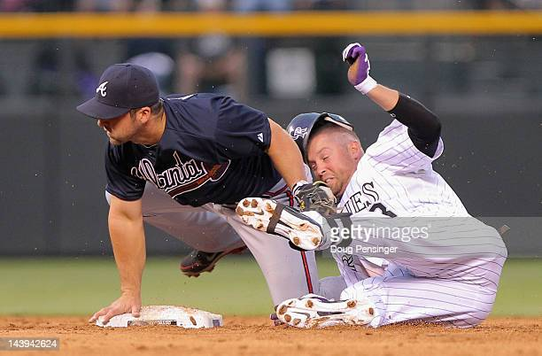 Michael Cuddyer of the Colorado Rockies is tagged out by second baseman Dan Uggla of the Atlanta Braves as he tried to stretch a single into a double...