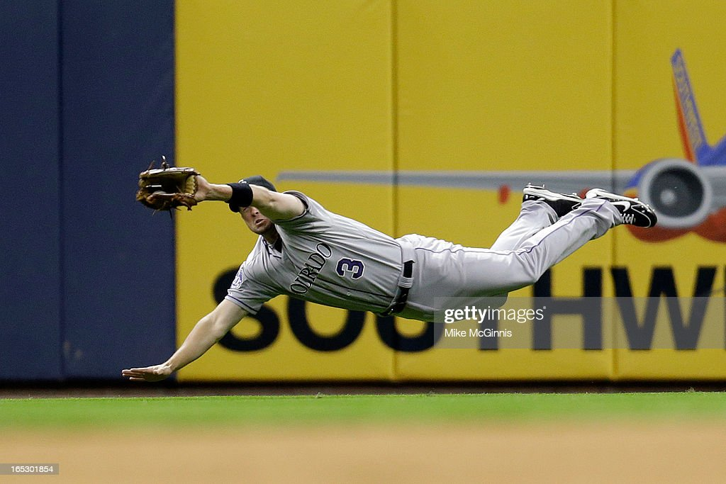 <a gi-track='captionPersonalityLinkClicked' href=/galleries/search?phrase=Michael+Cuddyer&family=editorial&specificpeople=208127 ng-click='$event.stopPropagation()'>Michael Cuddyer</a> #3 of the Colorado Rockies makes an outstanding jumping catch in right field to rob Alex Gonzalez of the Milwaukee Brewers during the bottom of the 8th inning at Miller Park on April 2, 2013 in Milwaukee, Wisconsin.