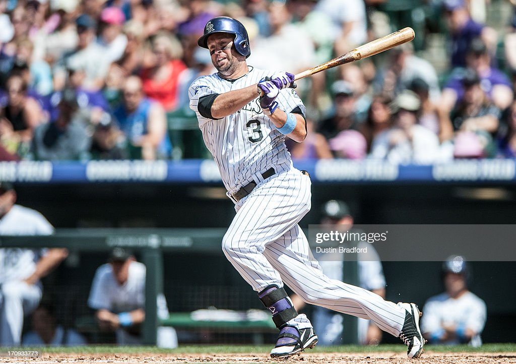 <a gi-track='captionPersonalityLinkClicked' href=/galleries/search?phrase=Michael+Cuddyer&family=editorial&specificpeople=208127 ng-click='$event.stopPropagation()'>Michael Cuddyer</a> #3 of the Colorado Rockies puts a ball in play against the Philadelphia Phillies during a game at Coors Field on June 16, 2013 in Denver, Colorado. The Rockies beat the Phillies 5-2.