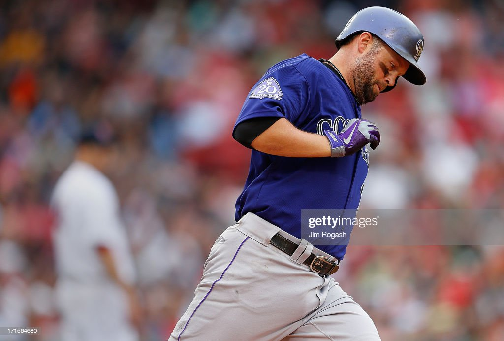 Michael Cuddyer #3 of the Colorado Rockies rounds the bases after hitting a home run against John Lackey #41 of the Boston Red Sox at the plate in the 6th inning at Fenway Park on June 26, 2013 in Boston, Massachusetts.