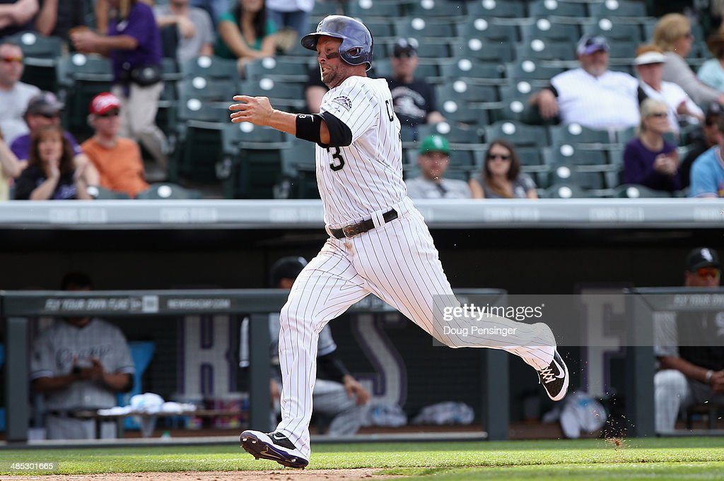 <a gi-track='captionPersonalityLinkClicked' href=/galleries/search?phrase=Michael+Cuddyer&family=editorial&specificpeople=208127 ng-click='$event.stopPropagation()'>Michael Cuddyer</a> #3 of the Colorado Rockies runs home to score against the Chicago White Sox during Interleague play at Coors Field on April 9, 2014 in Denver, Colorado. The Rockies defeated the White Sox 10-4.
