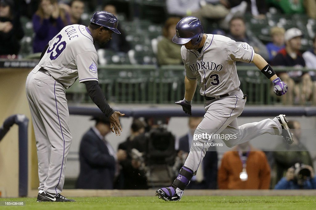 <a gi-track='captionPersonalityLinkClicked' href=/galleries/search?phrase=Michael+Cuddyer&family=editorial&specificpeople=208127 ng-click='$event.stopPropagation()'>Michael Cuddyer</a> #3 of the Colorado Rockies runs the bases after hitting a two-run homer scoring Reid Brignac in the top of the ninth inning against the Milwaukee Brewers at Miller Park on April 3, 2013 in Milwaukee, Wisconsin.