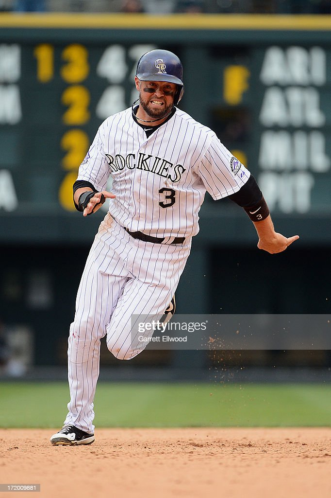 <a gi-track='captionPersonalityLinkClicked' href=/galleries/search?phrase=Michael+Cuddyer&family=editorial&specificpeople=208127 ng-click='$event.stopPropagation()'>Michael Cuddyer</a> #3 of the Colorado Rockies runs towards third base in the eighth inning of the game against the San Francisco Giants at Coors Field on June 30, 2013 in Denver, Colorado.