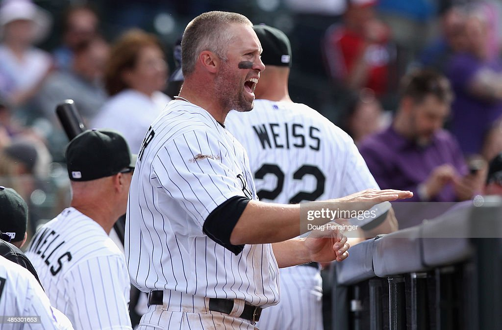 <a gi-track='captionPersonalityLinkClicked' href=/galleries/search?phrase=Michael+Cuddyer&family=editorial&specificpeople=208127 ng-click='$event.stopPropagation()'>Michael Cuddyer</a> #3 of the Colorado Rockies supports his teammates from the dugout against the Chicago White Sox during Interleague play at Coors Field on April 9, 2014 in Denver, Colorado. The Rockies defeated the White Sox 10-4.