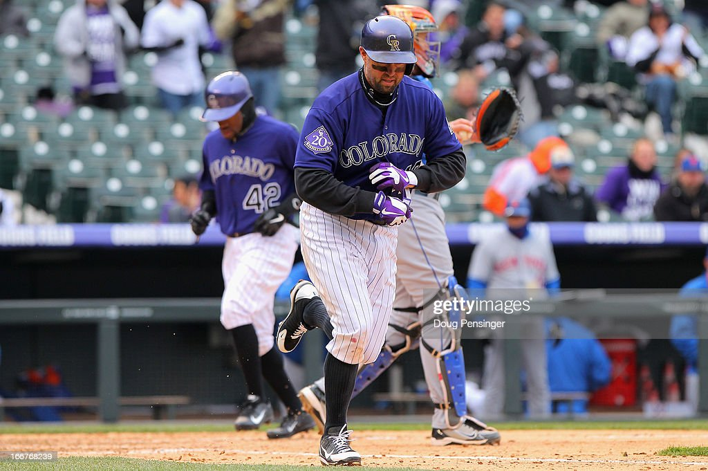 <a gi-track='captionPersonalityLinkClicked' href=/galleries/search?phrase=Michael+Cuddyer&family=editorial&specificpeople=208127 ng-click='$event.stopPropagation()'>Michael Cuddyer</a> (R) of the Colorado Rockies takes a bases loaded walk to score Eric Young Jr. (L) of the Colorado Rockies against the New York Mets in the fifth inning at Coors Field on April 16, 2013 in Denver, Colorado. All uniformed team members are wearing jersey number 42 in honor of Jackie Robinson Day.