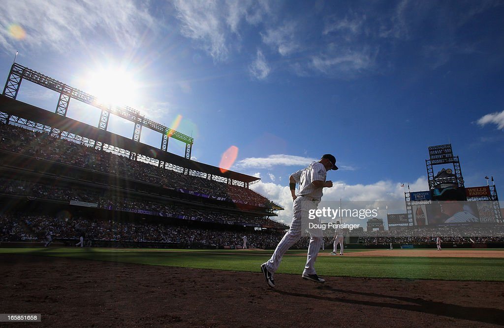 <a gi-track='captionPersonalityLinkClicked' href=/galleries/search?phrase=Michael+Cuddyer&family=editorial&specificpeople=208127 ng-click='$event.stopPropagation()'>Michael Cuddyer</a> #3 of the Colorado Rockies takes the field against the San Diego Padres during Opening Day at Coors Field on April 5, 2013 in Denver, Colorado. The Rockies defeated the Padres 5-2.