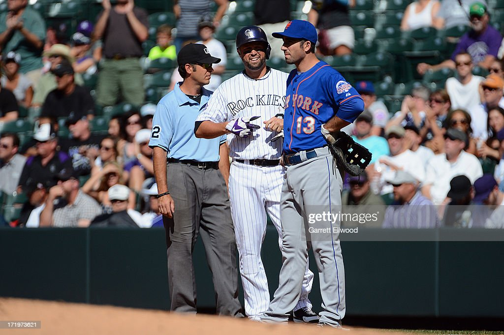 <a gi-track='captionPersonalityLinkClicked' href=/galleries/search?phrase=Michael+Cuddyer&family=editorial&specificpeople=208127 ng-click='$event.stopPropagation()'>Michael Cuddyer</a> #3 of the Colorado Rockies waits on first base after extending his career-long hitting streak to 24 hits breaking a team record during the second inning of the game against the New York Mets at Coors Field on June 27, 2013 in Denver, Colorado. Photo by Garrett W. Ellwood/Getty Images)