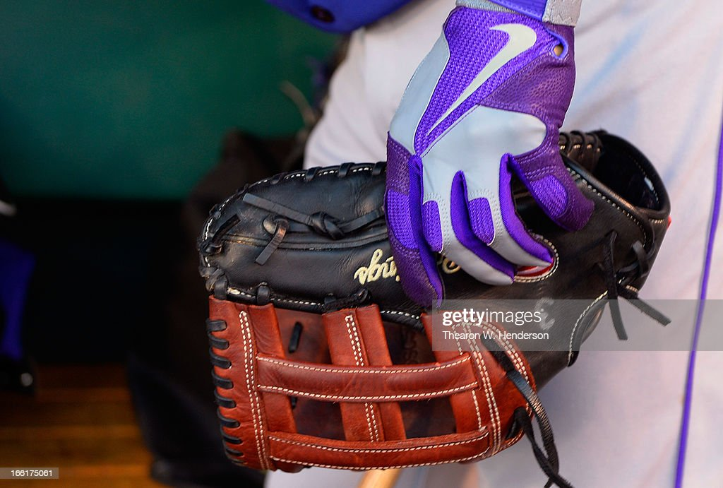 Michael Cuddyer #3 of the Colorado Rockies wearing Nike batting gloves, holds onto his Rawlings first baseman's glove in the dugout before the start of his game against the San Francisco Giants at AT&T Park on April 8, 2013 in San Francisco, California.