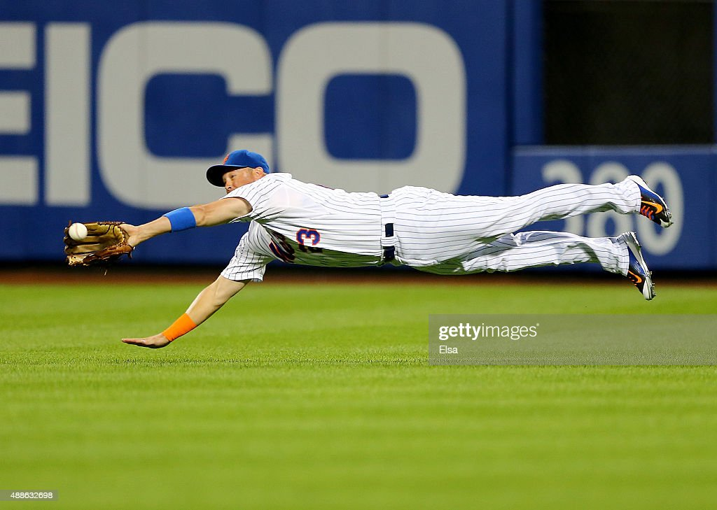 Michael Cuddyer #23 of the New York Mets catches a hit by Martin Prado of the Miami Marlins for the out in the first inning on September 16, 2015 at Citi Field in the Flushing neighborhood of the Queens borough of New York City.