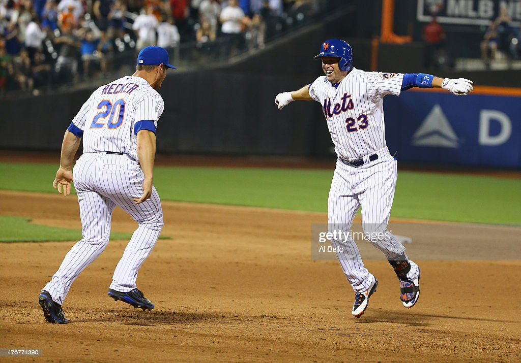 Michael Cuddyer #23 of the New York Mets celebrates his walk off single to win the game 5-4 with Anthony Recker #20 against the San Francisco Giants during their game at Citi Field on June 11, 2015 in New York City.