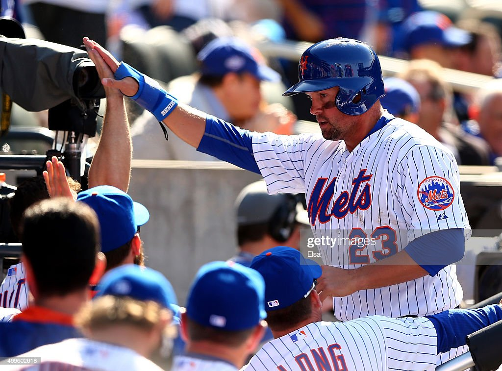 Michael Cuddyer #23 of the New York Mets is congratulated by teammates in the dugout after he scored in the eightth inning against the Philadelphia Phillies during Opening Day on April 13, 2015 at Citi Field in the Flushing neighborhood of the Queens borough of New York City.