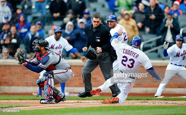 Michael Cuddyer of the New York Mets scores a run in the first inning after a double from teammate Daniel Murphy as AJ Pierzynski of the Atlanta...