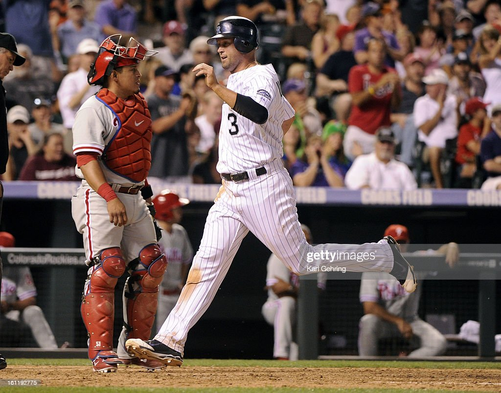 Michael Cuddyer scored from third after a pick off throw from catcher Carlos Ruiz sailed past third baseman Placido Polanco. The Colorado Rockies defeated the Philadelphia Phillies 6-2 at Coors Field Friday night, July 13, 2012. Karl Gehring/The Denver Post