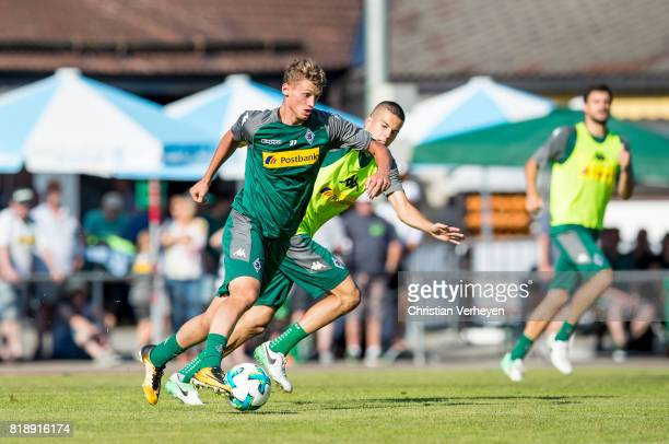 Michael Cuisance is chased by Laszlo Benes during a training session at the Training Camp of Borussia Moenchengladbach on July 19 2017 in...