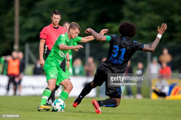 Michael Cuisance of Borussia Moenchengladbach and Dante of OGC Nice battle for the ball during a friendly match between Borussia Moenchengladbach and...