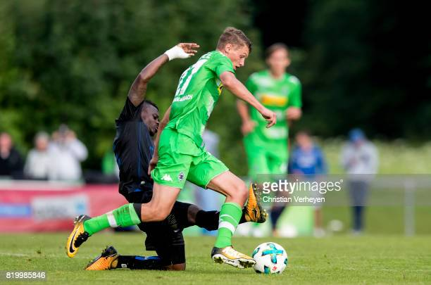 Michael Cuisance of Borussia Moenchengladbach and Jean Michael Seri of OGC Nice battle for the ball during a friendly match between Borussia...