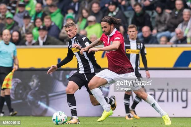 Michael Cuisance of Borussia Monchengladbach Martin Harnik of Hannover 96 during the Bundesliga match between Borussia Monchengladbach and Hannover...