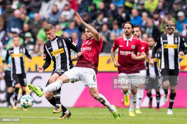 Michael Cuisance of Borussia Monchengladbach Marvin Bakalorz of Hannover 96 during the Bundesliga match between Borussia Monchengladbach and Hannover...