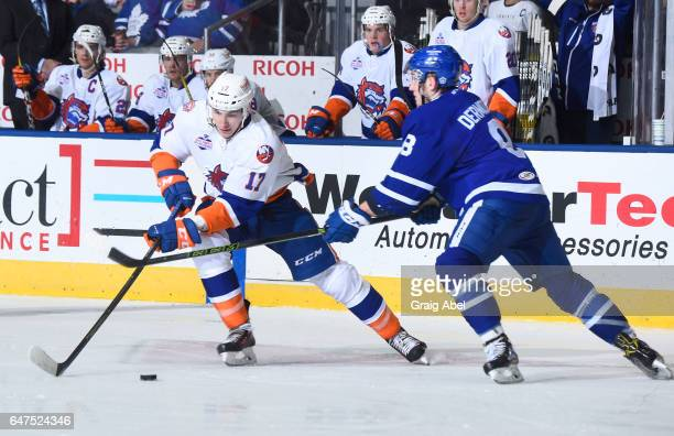 Michael Dal Colle of the Bridgeport Sound Tigers controls the puck against Travis Dermott of the Toronto Marlies during AHL game action on March 2...