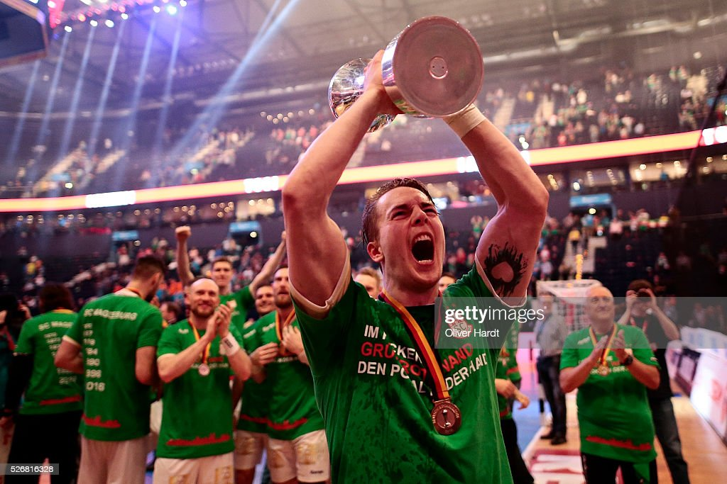 Michael Damgaard of Magdeburg celebrate with the trophy after winning the DKB REWE Final Four Finale 2016 between SG Flensburg Handewitt and SC Magdeburg at Barclaycard Arena on May 1, 2016 in Hamburg, Germany.