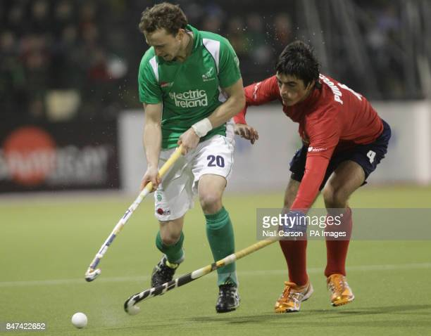 Michael Darling of Ireland and Juan Pablo Purcell of Chile during the FIH Olympic Games Qualifying Tournament at the Belfield Dublin PRESS...