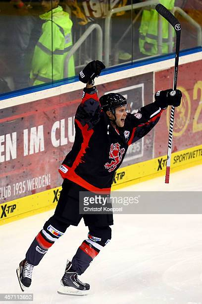 Michael Davies of Duesseldorfer EG celebrates the first goal during the DEL match between Duesseldorfer EG and Koelner Haie at ISS Dome on October 12...