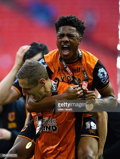 Michael Dawson and Chuba Akpom of Hull City celebrate winning the Sky Bet Championship Play Off Final match between Hull City and Sheffield Wednesday...