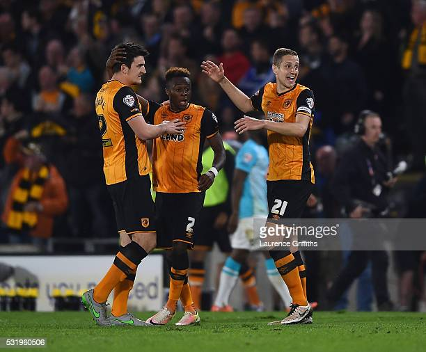 Michael Dawson and Moses Odubajo of Hull City celebrate on the final whistle during the Sky Bet Championship Play Off semi final second leg match...
