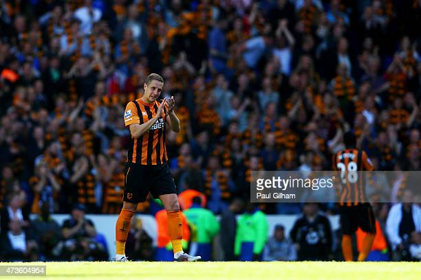 Michael Dawson of Hull City applauds after his team's defeat in the Barclays Premier League match between Tottenham Hotspur and Hull City at White...