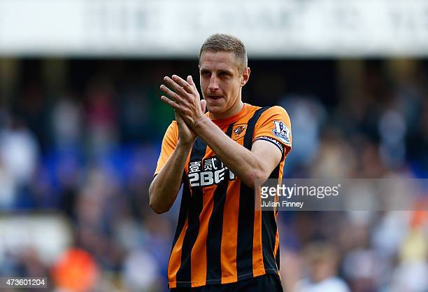 Michael Dawson of Hull City applauds fans after his team's defeat in the Barclays Premier League match between Tottenham Hotspur and Hull City at...