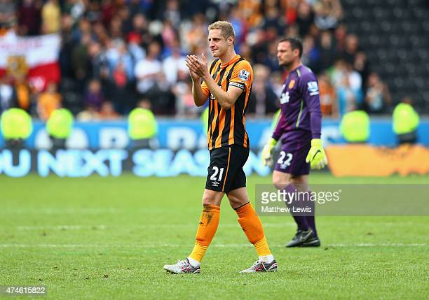Michael Dawson of Hull City applauds supporters after relegated from the Premier League during the Barclays Premier League match between Hull City...