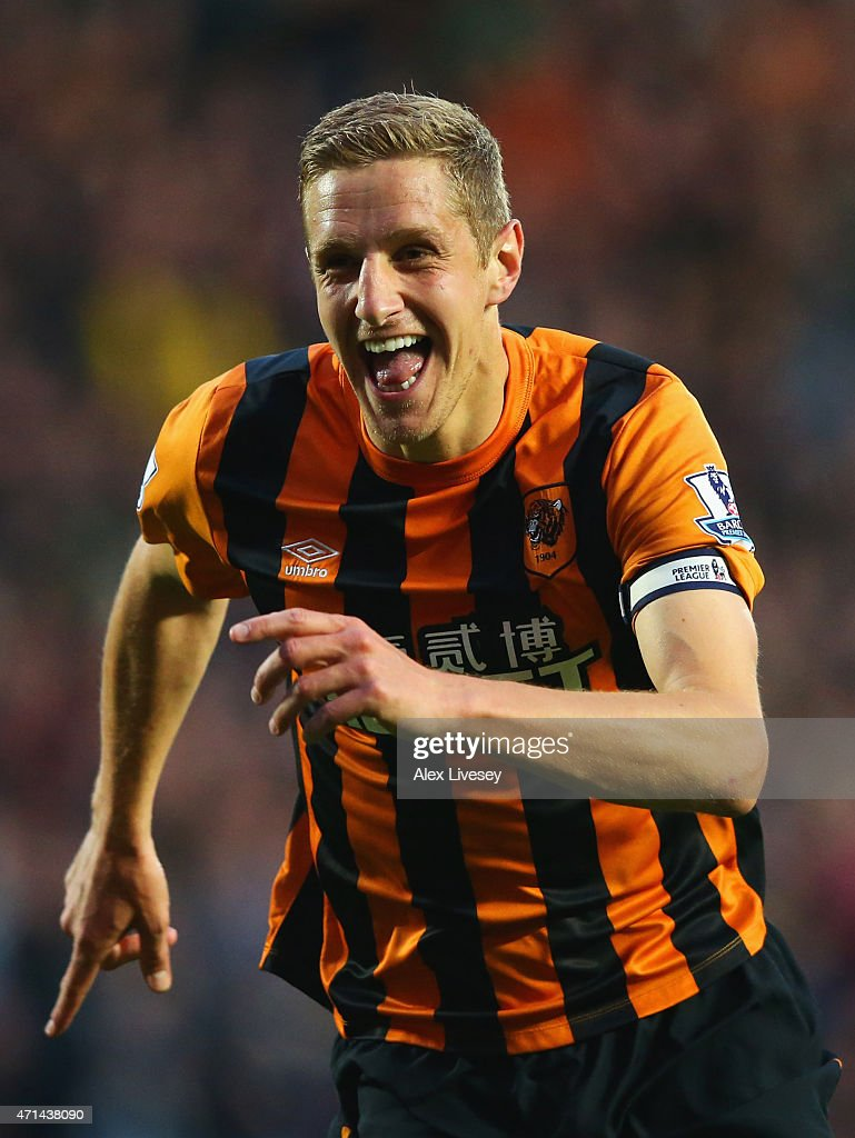 Michael Dawson of Hull City celebrates as he scores their first goal during the Barclays Premier League match between Hull City and Liverpool at KC Stadium on April 28, 2015 in Hull, England.