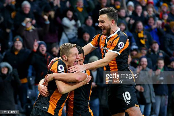 Michael Dawson of Hull City celebrates scoring his sides second goal with Robert Snodgrass of Hull City during the Premier League match between Hull...