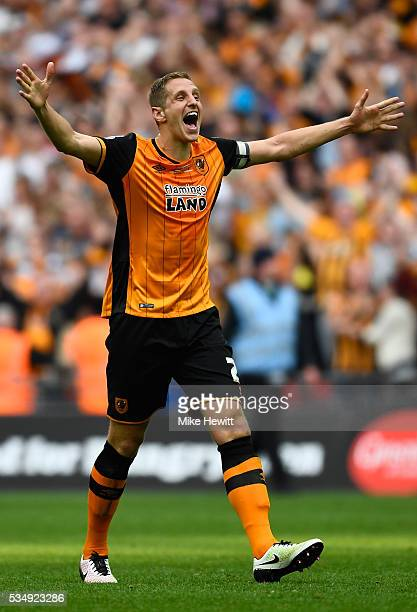 Michael Dawson of Hull City celebrates winning and promotion to the Premier League after the Sky Bet Championship Play Off Final match between Hull...