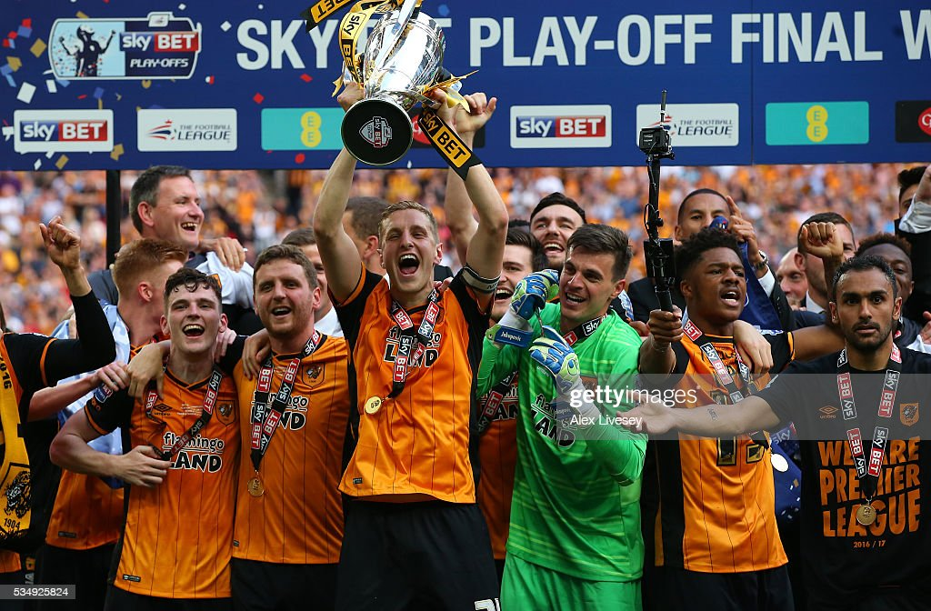 <a gi-track='captionPersonalityLinkClicked' href=/galleries/search?phrase=Michael+Dawson+-+Soccer+Player&family=editorial&specificpeople=453217 ng-click='$event.stopPropagation()'>Michael Dawson</a> of Hull City leads the celebrations after Sky Bet Championship Play Off Final match between Hull City and Sheffield Wednesday at Wembley Stadium on May 28, 2016 in London, England.