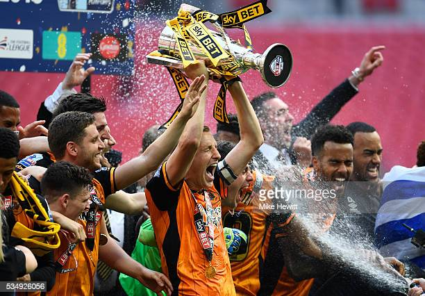 Michael Dawson of Hull City leads the celebrations after victory in the Sky Bet Championship Play Off Final match between Hull City and Sheffield...