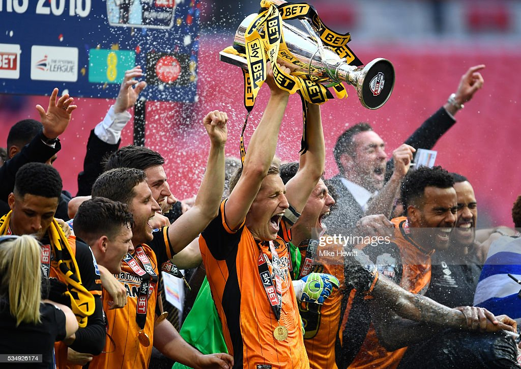 <a gi-track='captionPersonalityLinkClicked' href=/galleries/search?phrase=Michael+Dawson&family=editorial&specificpeople=453217 ng-click='$event.stopPropagation()'>Michael Dawson</a> of Hull City leads the celebrations after victory in the Sky Bet Championship Play Off Final match between Hull City and Sheffield Wednesday at Wembley Stadium on May 28, 2016 in London, England.