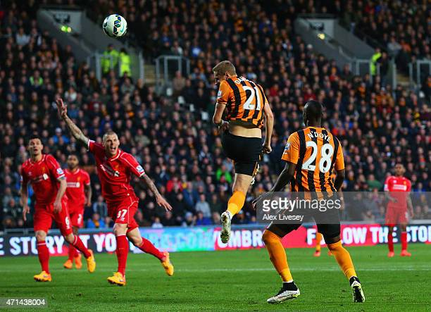 Michael Dawson of Hull City scores their first goal during the Barclays Premier League match between Hull City and Liverpool at KC Stadium on April...