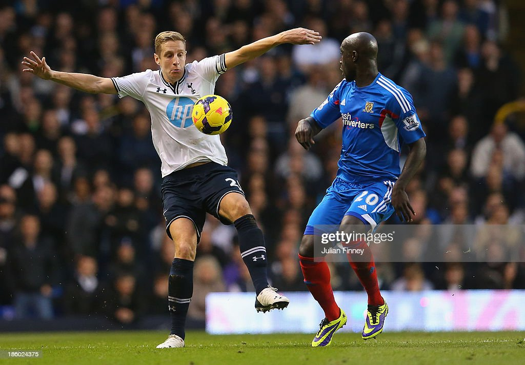 Michael Dawson of Spurs and Yannick Sagbo of Hull City compete for the ball during the Barclays Premier League match between Tottenham Hotspur and Hull City at White Hart Lane on October 27, 2013 in London, England.