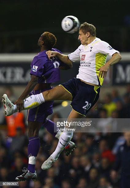 Michael Dawson of Spurs heads above Louis Saha of Everton during the Carling Cup 4th Round match between Tottenham Hotspur and Everton at White Hart...