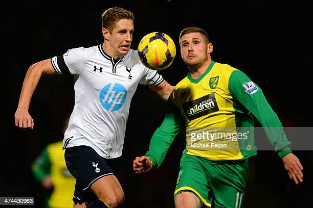 Michael Dawson of Tottenham Hotspur and Gary Hooper of Norwich City compete for the ball during the Barclays Premier League match between Norwich...