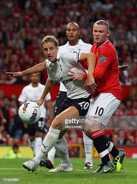 Michael Dawson of Tottenham Hotspur and Wayne Rooney of Manchester United battle for the ball during the Barclays Premier League match between...