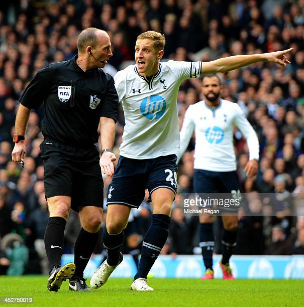 Michael Dawson of Tottenham Hotspur appeals to Referee Mike Dean during the Barclays Premier League Match between Tottenham Hotspur and Manchester...