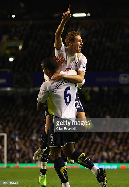Michael Dawson of Tottenham Hotspur celebrates scoring his team's second goal with team mate Tom Huddlestone during the Barclays Premier League match...