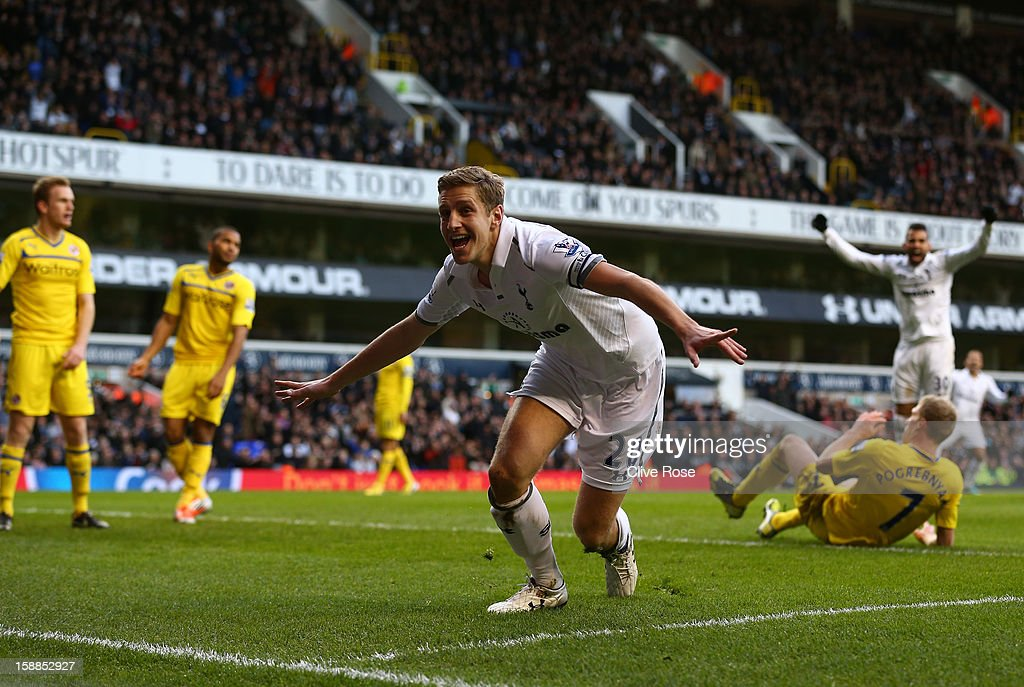 <a gi-track='captionPersonalityLinkClicked' href=/galleries/search?phrase=Michael+Dawson+-+Soccer+Player&family=editorial&specificpeople=453217 ng-click='$event.stopPropagation()'>Michael Dawson</a> of Tottenham Hotspur celebrates scoring their first goal during the Barclays Premier League match between Tottenham Hotspur and Reading at White Hart Lane on January 1, 2013 in London, England.